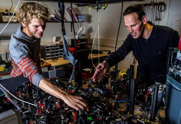 Photo of two scientists working on a quantum mechanics project.