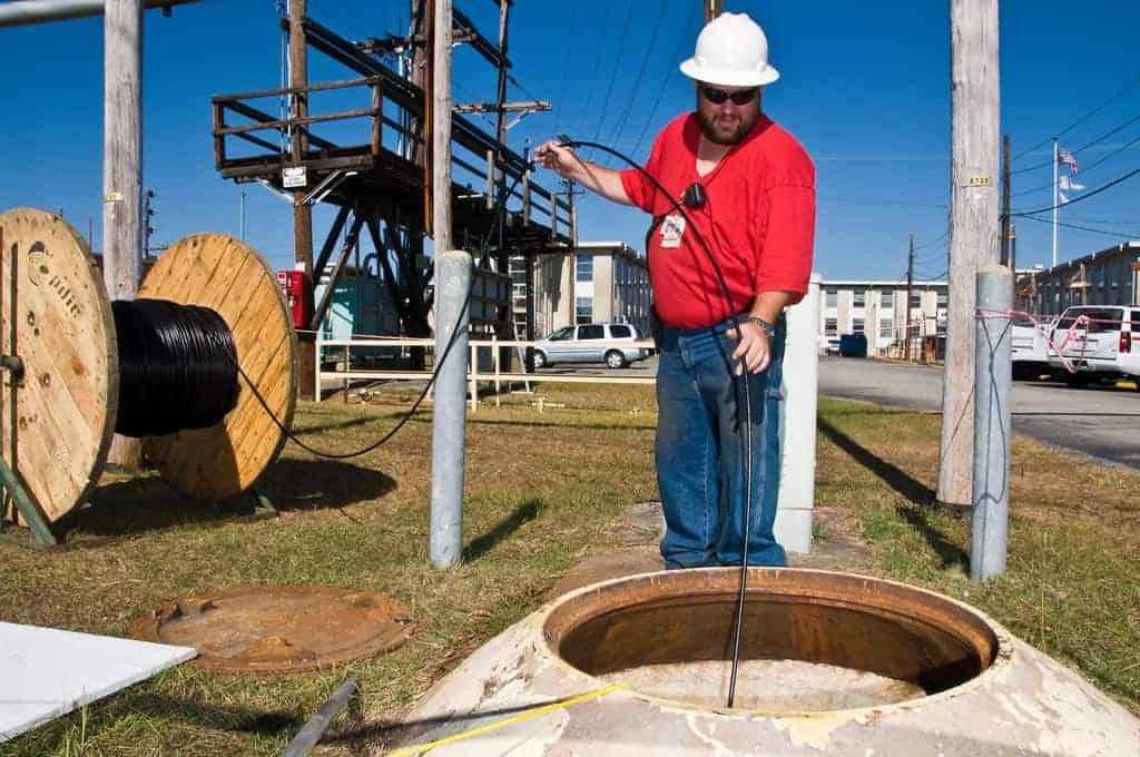 Technician installing fiber in the last mile.