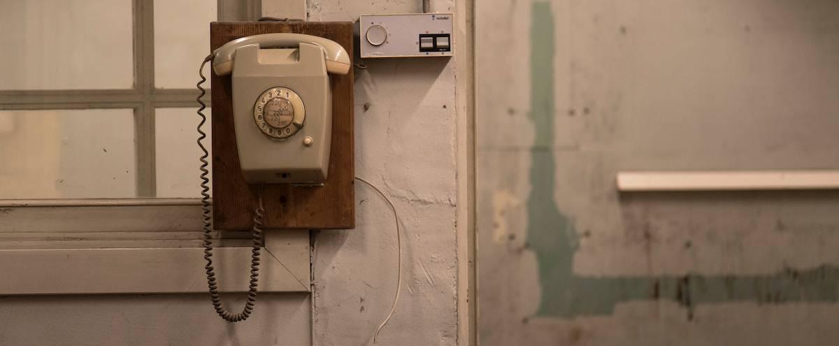 landline phone on a wall.